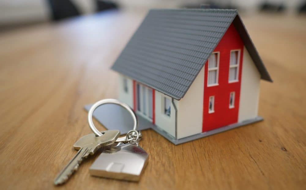 picture of a key next to a small model home